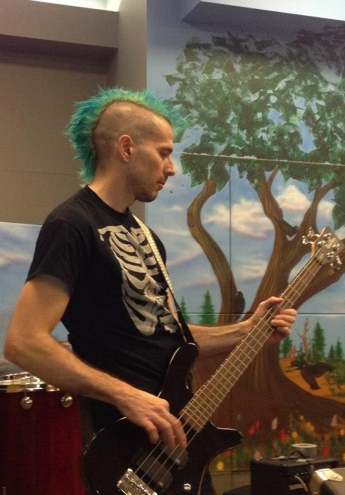 Ian Kroll, bass player for the band Fluffy The Pitbull